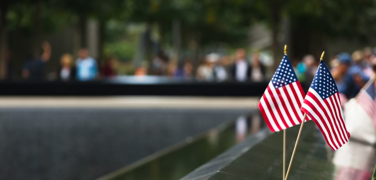 two american flags sitting at the 9/11 memorial site